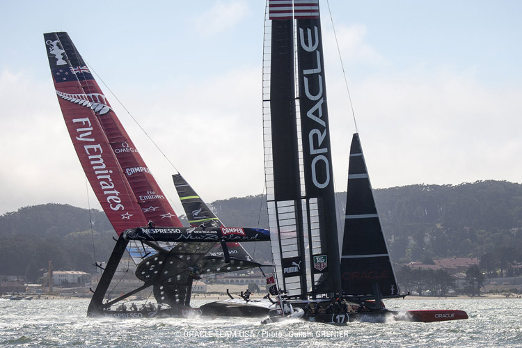 Emirates Team New Zealand and Oracle Team USA race in the 2013 America's Cup.  Click image to  read more.  Photo:©2013 Guilain Grenier