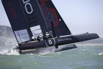 America's Cup AC45 catamaran on a wave in San FRancisco Bay. Photo copyright 2011 Gilles Martin-Raget americascup.com