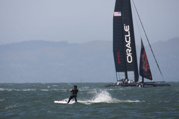 America's Cup AC45 catamaran and kiteboarder in San Francisco Bay. Photo copyright 2011 Gilles Martin-Raget americascup.com