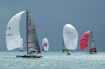 America's Cup Class yachts flying spinnakers in Louis Vuitton Act 13.