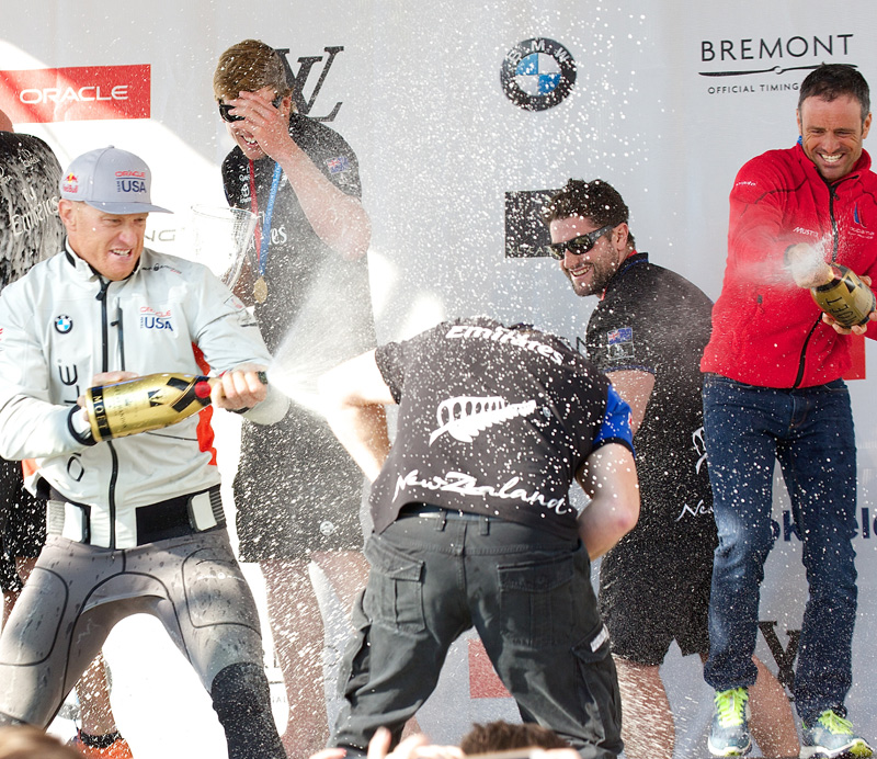 Skippers help each other cool down after the races. Oracle's Jimmy Spithill, left, ETNZ's Peter Burling, center, and Groupama Team France's Franck Cammas, right.