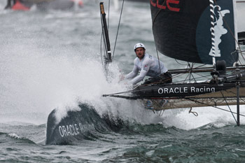 Oracle Racing AC45 slices through the waves in San Diego. Photo:�2011 ACEA/Gilles Martin-Raget